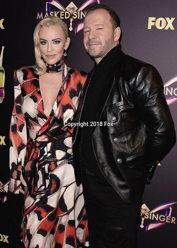 """WEST HOLLYWOOD - DECEMBER 13:  Jenny McCarthy and Donnie Wahlberg at the premiere karaoke event for season one of """"The Masked Singer"""" at The Peppermint Club on December 13, 2018 in West Hollywood, California. (Photo by Scott Kirkland/Fox/PictureGroup)"""