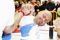 """Chris Perka tries to take an opponent down at the Empire State Finals at the Port Authority Bus Terminal in New York City on November 17, 2005.  The Empire State Finals is the culmination in the year of the New York City Arm Wrestling Association's """"Golden Arm Series""""."""