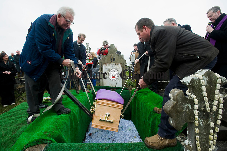 The coffin bearing the remains of musician Joe Ryan is lowered into  the family grave at Inagh. Photograph by John Kelly.