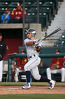 Bryant Miranda #12 of the Coppin State Eagles bats during a game against the Southern California Trojans at Dedeaux Field on February 18, 2017 in Los Angeles, California. Southern California defeated Coppin State, 22-2. (Larry Goren/Four Seam Images)