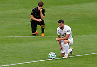 LOS ANGELES, CA - OCTOBER 25: Francisco Ginella #8 of LAFC Sebastian Lletget #17 each take a knee during a game between Los Angeles Galaxy and Los Angeles FC at Banc of California Stadium on October 25, 2020 in Los Angeles, California.
