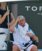 18-06-13, Netherlands, Rosmalen,  Autotron, Tennis, Topshelf Open 2013, , Xavier Malisse cooling himself down with water<br /> Photo: Henk Koster