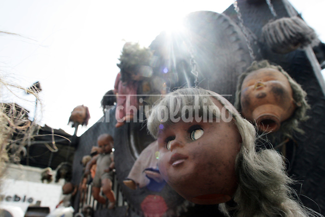 """Voodoo dolls on a street in downtown Caracas, part of an  essay by Howard Yanes The Borders of Faith in Venezuela. Howard says :""""This are religions or beliefs from which no one speaks clearly but everydoby  knows they exist. Everybody pretends they are irrelevant, some of them even could laugh about this beliefs  but nobody would dare to remove those pieces of voodoo ceremony you can find at any cementery, or to close down the illegal shops selling animals for sacrifice."""""""