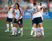 Angela Hucles (16), Abby Wambach (20), Megan Rapinoe. The US Women's National Team defeated the Canadian Women's National Team, 4-0, at BMO Field in Toronto during an international friendly soccer match on May 25, 2009.