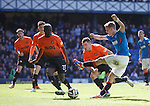 Dean Shiels finds himself heavily outnumbered in the Dundee Utd box