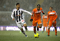 Pictured: Scott Sinclair of Swansea (R) challenged by Paul Scharner  (L) of West Bromwich. Saturday, 04 February 2012<br /> Re: Premier League football, West Bromwich Albion v Swansea City FC v at the Hawthorns Stadium, Birmingham, West Midlands.