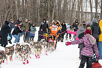 Thomas Waerner and team run past spectators on the bike/ski trail near University Lake with an Iditarider in the basket and a handler during the Anchorage, Alaska ceremonial start on Saturday, March 7 during the 2020 Iditarod race. Photo © 2020 by Ed Bennett/Bennett Images LLC