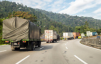 Malaysia.  Truck Traffic Going North on Highway AH2 between Ipoh and Taiping.