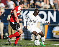 Darren Mattocks #11of the University of Akron moves the ball towards Paolo DelPiccolo #3 of the University of Louisville during the 2010 College Cup final at Harder Stadium, on December 12 2010, in Santa Barbara, California.Akron champions, 1-0.