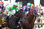 May 17, 2014. First time by the stands, #6 Ria Antonia, Calvin Borel up, races alongside eventual winner California Chrome (Victor Espinoza up) in the 139th Preakness Stakes at Pimlico Race Course in Baltimore, MD. ©Joan Fairman Kanes/ESW/CSM