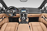 Stock photo of straight dashboard view of a 2014 Porsche Cayenne Platinum Edition 5 Door SUV Dashboard