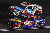 CONCORD, NORTH CAROLINA - MAY 24: Martin Truex Jr., driver of the #19 Bass Pro Shops/TRACKER/USO Toyota, leads Kyle Busch, driver of the #18 M&M's Red White Blue Toyota, during the NASCAR Cup Series Coca-Cola 600 at Charlotte Motor Speedway on May 24, 2020 in Concord, North Carolina. (Photo by Chris Graythen/Getty Images)