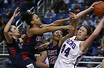 From left, Liberty Patriots Jazmin O'Bannon, Aubre' Fortner and Paris Strawther fight for a rebound with Reno's Mallory McGwire during the Division I championship game in the NIAA basketball state tournament at Lawlor Events Center, in Reno, Nev., on Friday, Feb. 28, 2014. Reno won the state title 50-39. (Cathleen Allison/Las Vegas Review-Journal)