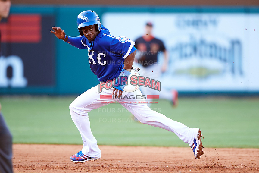 Oklahoma City Dodgers second baseman Darnell Sweeney (9) running the bases during a game against the Fresno Grizzles on June 1, 2015 at Chickasaw Bricktown Ballpark in Oklahoma City, Oklahoma.  Fresno defeated Oklahoma City 14-1.  (Mike Janes/Four Seam Images)