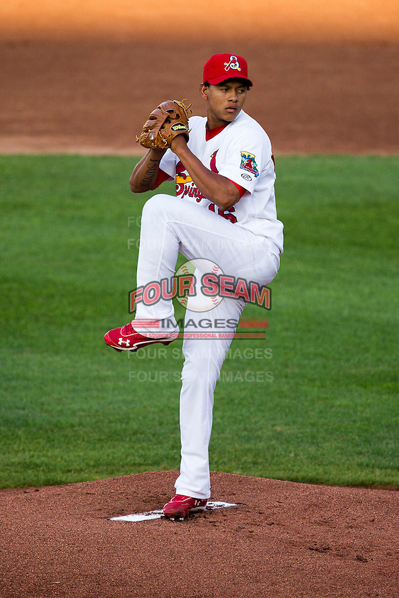 Carlos Martinez (16) of the Springfield Cardinals winds up during a game against the Arkansas Travelers at Hammons Field on July 24, 2012 in Springfield, Missouri. (David Welker/Four Seam Images)