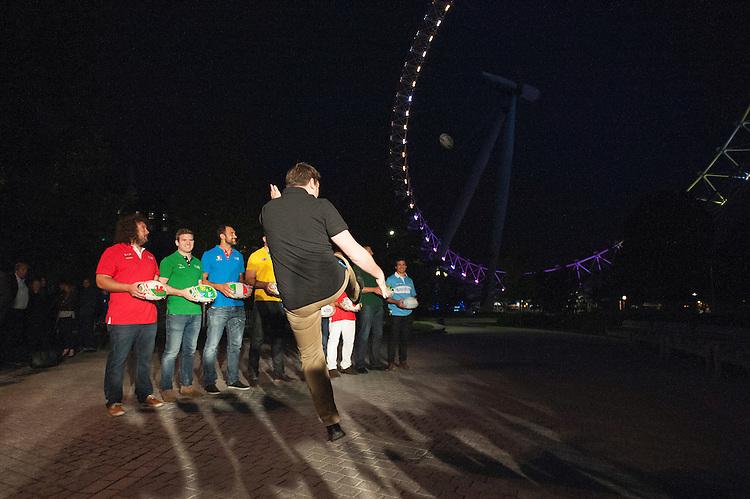 Andrew Mehrtens (New Zealand) kicks the ball towards the The London Eye to launch the Rugby World Cup England 2015 in front of Adam Jones (Wales), Gordon D'Arcy (Ireland), Marco Bortolami (Italy), Jason Robinson (England), James Horwill (Australia), Masaaki Sakata (Japan), Bob Skinstad (South Africa), Gonzalo Camacho (Argentina) - 15/09/2015 - London Eye - London <br /> Mandatory Credit: Rob Munro/Stewart Communications