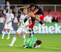 WASHINGTON, DC - MAY 13: Edison Flores #10 of D.C. United jumps over Bobby Shuttleworth #1 of Chicago Fire FC during a game between Chicago Fire FC and D.C. United at Audi FIeld on May 13, 2021 in Washington, DC.