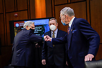 WASHINGTON, DC - FEBRUARY 22:  (L-R) Attorney General nominee Merrick Garland is greeted by United States Senator Dick Durbin (Democrat of Illinois), Chairman, US Senate Committee on the Judiciary and US Senator Chuck Grassley (Republican of Iowa), Ranking Member, US Senate Committee on the Judiciary as he arrives for his confirmation hearing before the Senate Judiciary Committee in the Hart Senate Office Building on February 22, 2021 in Washington, DC. Garland previously served at the Chief Judge for the U.S. Court of Appeals for the District of Columbia Circuit. <br /> Credit: Drew Angerer / Pool via CNP /MediaPunch