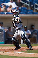 Lynchburg Hillcats catcher Andres Melendez (20) makes a throw to first base against the Kannapolis Cannon Ballers at Atrium Health Ballpark on August 29, 2021 in Kannapolis, North Carolina. (Brian Westerholt/Four Seam Images)