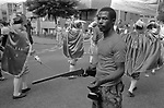 Notting Hill Carnival 1981. Man with realistic toy rifle gun 1980s UK