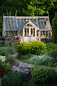 Greenhouse in early morning sunlight, early May.