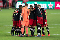 WASHINGTON, DC - SEPTEMBER 12: D.C. United players huddle during a game between New York Red Bulls and D.C. United at Audi Field on September 12, 2020 in Washington, DC.