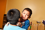 Toddler program two year old boy clinging to older cousin crying separation from mother