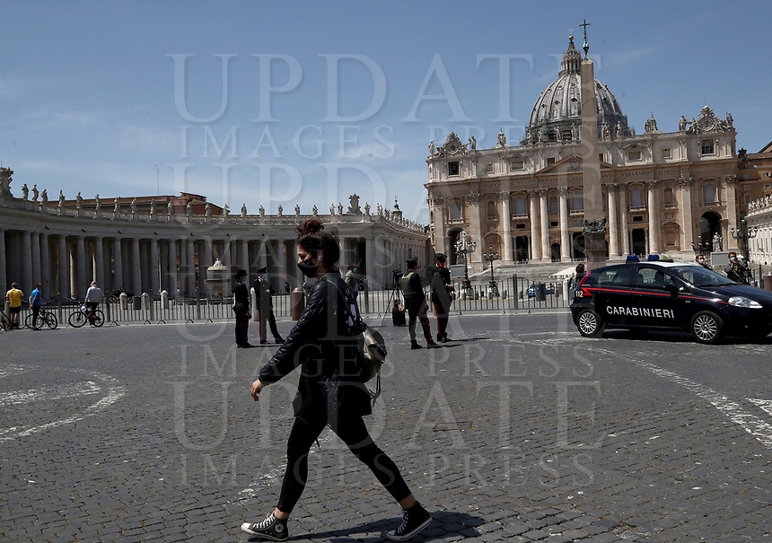 A woman walks  outside the square after Pope Francis delivers his blessing from the window of the Apostolic palace overlooking an empty St Peter' Square, after his live-streamed Angelus prayer on May 10, 2020 at the Vatican. St Peter' square is closed off to the public due to the novel coronavirus, COVID-19, pandemic.<br /> UPDATE IMAGES PRESS/Isabella Bonotto<br /> <br /> STRICTLY ONLY FOR EDITORIAL USE