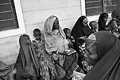 Somali refugees wait at the reception centre in IFO-1camp in the Dadaab refugee camp in northeastern Kenya. Photo: Sanjit Das/Panos