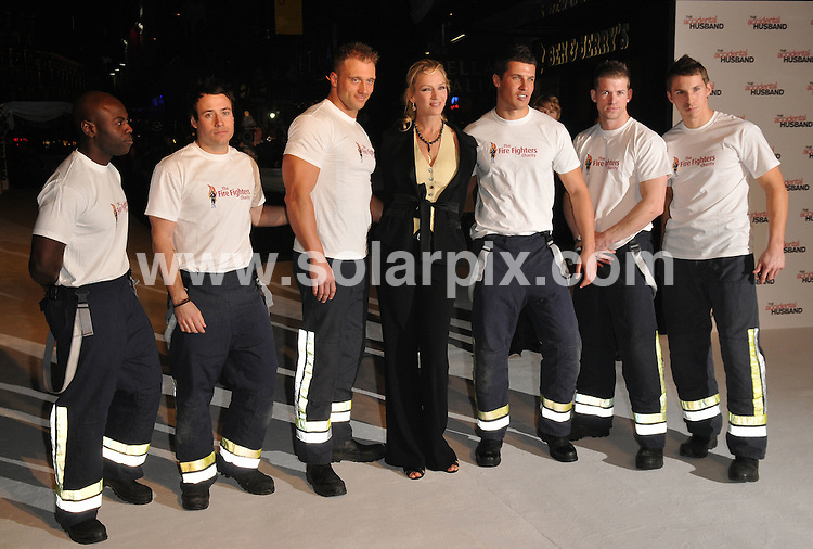 **ALL ROUND PICTURES FROM SOLARPIX.COM**.**WORLDWIDE SYNDICATION RIGHTS**.The film premiere of 'The Accidental Husband' in London. 13th February 2008..This pic: Uma Thurman with Firemen..JOB REF: 5778 ATM     DATE: 13_02_2008.**MUST CREDIT SOLARPIX.COM OR DOUBLE FEE WILL BE CHARGED* *UNDER NO CIRCUMSTANCES IS THIS IMAGE TO BE REPRODUCED FOR ANY ONLINE EDITION WITHOUT PRIOR PERMISSION*