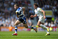 George Ford of Bath Rugby is chased by Jacques Burger of Saracens during the Aviva Premiership Rugby Final between Bath Rugby and Saracens at Twickenham Stadium on Saturday 30th May 2015 (Photo by Rob Munro)