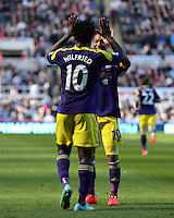 Pictured L-R: Wilfried Bony of Swansea celebrating his equaliser with team mate Jonathan de Guzman. Saturday 19 April 2014<br /> Re: Barclay's Premier League, Newcastle United v Swansea City FC at St James Park, Newcastle, UK.