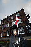 © Joel Goodman - 07973 332324 . 02/04/2011 . Blackburn , UK . An EDL supporter in Medieval costume carrying an England flag . The English Defence League ( EDL ) hold a demonstration in Blackburn . Photo credit : Joel Goodman