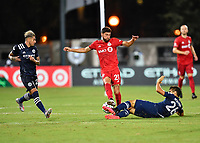 LAKE BUENA VISTA, FL - JULY 26: Jonathan Osorio of Toronto FC tries to get by a challenge by Nicolás Acevedo of New York City FC during a game between New York City FC and Toronto FC at ESPN Wide World of Sports on July 26, 2020 in Lake Buena Vista, Florida.