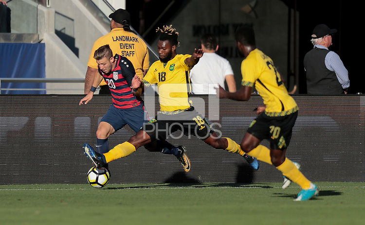 Santa Clara, CA - Wednesday July 26, 2017: Paul Arriola and Owayne Gordon during the 2017 Gold Cup Final Championship match between the men's national teams of the United States (USA) and Jamaica (JAM) at Levi's Stadium.