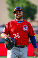 Buffalo Bisons first baseman Rowdy Tellez (34) warms up in the outfield prior to an International League game against the Indianapolis Indians on July 28, 2018 at Victory Field in Indianapolis, Indiana. Indianapolis defeated Buffalo 6-4. (Brad Krause/Four Seam Images)