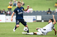 3rd January 2021; Campbelltown Stadium, Leumeah, New South Wales, Australia; A League Football, Macarthur FC versus Central Coast Mariners; Loic Puyo of Macarthur FC slides in to tackle Oliver Bozanic of Central Coast Mariners