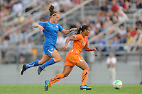 Lauren Cheney (8) of the Boston Breakers jumps over the legs of Rosana (11) of Sky Blue FC. Sky Blue FC and the Boston Breakers played to a 0-0 tie during a Women's Professional Soccer (WPS) match at Yurcak Field in Piscataway, NJ, on May 29, 2010.