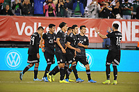 EAST RUTHERFORD, NJ - SEPTEMBER 7: Uriel Antuna #26 of Mexico celebrates his score with team mates during a game between Mexico and USMNT at MetLife Stadium on September 6, 2019 in East Rutherford, New Jersey.