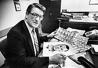 Process of elimination: Police inspector Jim Majury, who has been making composite drawings of suspects for 23 years, starts by showing witnesses photographs illustrating different facial shapes. Once one has been picked, it's a matter of having the witnesses list features that do not fit the suspect, he said. One drawing was recognized by a suspect's family.<br /> <br /> Photo : Boris Spremo - Toronto Star archives - AQP
