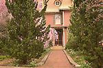 Brick walkway to front door of old federal style home