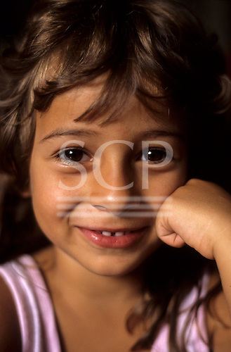 Rio de Janeiro, Brazil. Anisha, a smiling girl of about 8 with brown eyes and fair skin and hair.
