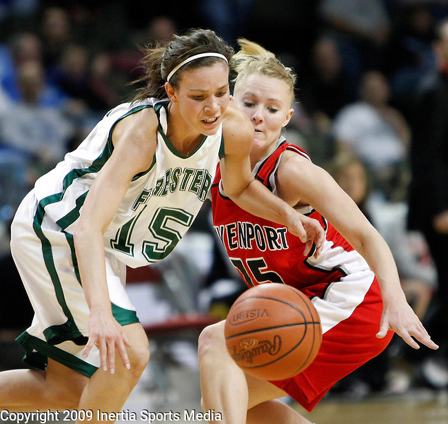 SIOUX CITY, IA - MARCH 13, 2009 --  Sarah Miller #15 of Huntington University (left) and Kristi Boehm #15 of Davenport University catch up with a loose ball during their game at the 2009 NAIA DII Women's National Championship at the Tyson Events Center in Sioux City, IA Friday. (Photo by Dick Carlson/Inertia)