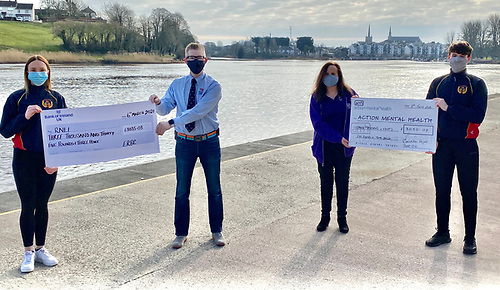 Tim Murphy (right) and Shannon Clawson (left)  handed over cheques to Rosie Maguire, Action Mental Health and Stephen Scott (second left) from the RNLI
