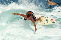 surfer surfing in North Kohola Lighthouse The Big Island of Hawaii