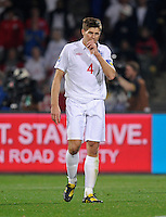 Steven Gerrard of England looks dejected after the goal scored by Clint Dempsey of USA, 1-1 at the half. USA vs England in the 2010 FIFA World Cup at Royal Bafokeng Stadium in Rustenburg, South Africa on June 12, 2010.