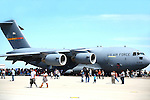 Air Show attendees cluster around the C-17, a large military transport aircraft.<br /> <br /> The C-17 Globemaster III is the newest, most flexible cargo aircraft to enter the airlift force. It is capable of rapid strategic delivery of troops and all types of cargo to main operating bases or directly to forward bases in the deployment area.<br /> (20)