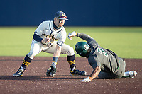 Michigan Wolverines second baseman Riley Bertram (12) attempts to tag Michigan State baserunner Zaid Walker (3) as slides into second on March 21, 2021 in NCAA baseball action at Ray Fisher Stadium in Ann Arbor, Michigan. Michigan scored 8 runs in the bottom of the ninth inning to defeat the Spartans 8-7. (Andrew Woolley/Four Seam Images)