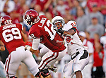 Oklahoma Sooners quarterback Landry Jones (12) and Ball State Cardinals cornerback Jeffery Garrett (24) in action during the game between the Ball State Cardinals  and the Oklahoma Sooners at the Oklahoma Memorial Stadium in Norman, Oklahoma. OU defeats Ball State 62 to 6.