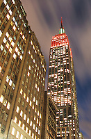 AVAILABLE FOR LICENSING FROM GETTY IMAGES.  <br /> <br /> PLEASE GO TO WWW.GETTYIMAGES.COM AND SEARCH FOR IMAGE # 200184770-001.<br /> <br /> Upward View of The Empire State Building at Dusk Illuminated Red and Green for the Christmas Season, Midtown Manhattan, New York City, New York State, USA